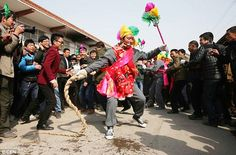 Whipping up a frenzy: One stage of the tradition is Pao Ma where men who have their faces pierced to whip the crowd with straw ropes