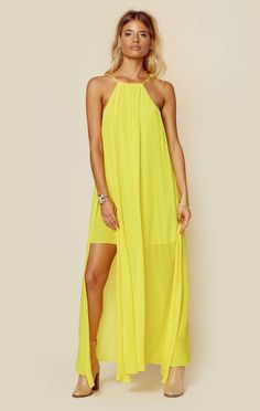 "Channel your bohemian beauty in Show Me Your Mumu's Bronte Maxi Dress. Featuring a vibrant yellow hue, side slits, racerback design, and mini slip underneath.  Made in USADry Clean OnlyPoly BlendFit Guide:Model is 5ft 9 inches; Bust: 34"", Waist: 25"", Hips: 35""Model is wearing a size XSRelaxed FitShoes Featured Not Available For Purchase"