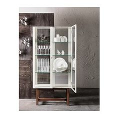 IKEA - STOCKHOLM, Glass-door cabinet, beige, , Glass-door cabinet in durable materials like tempered glass, solid wood and metal.The glass-door cabinet has large glass surfaces and is designed to include lighting so you can display your finest possessions.You can easily change the height according to your storage needs as the shelves are adjustable.The glass-door cabinet stays in place on uneven floors because it has adjustable feet.The door's integrated dampers enable it to close…
