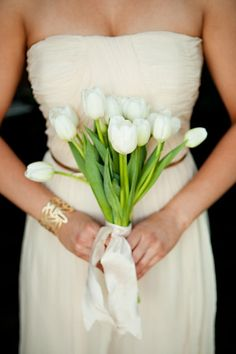 understated and yet a classic look bride's or bridesmaids bouquet of white tulips and satin ribbon