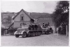 A Bussing-Nag  SdKfz 6 with a recovered StuG III Ausf G in German territory during 1945.