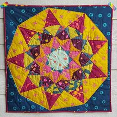 Dusk pattern by from blank pages, quilted by @supersara20. I love the saturated colors.