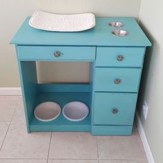I made it! Desk turned pet feeding station, cat on top, dog on bottom. No more of the dog getting the cat food. Painted with Shabby Paints.
