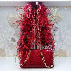 @ritzybagz Python handbag with ostrich feather chain