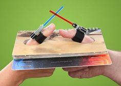 Star Wars Lightsaber Thumb Wrestling Book published by Chronicle Books for Lucasfilm Ltd.