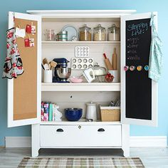 An armoire gets a new life as a baking center. Pin recipes and coupons on the corkboard.
