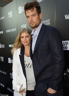Pregnant Fergie and alongside her husband Josh Duhamel