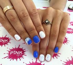 Really cute white and blue rose nail art design. The roses are painted on white over the bright blue background. The nail art design looks so fresh and fun to don.
