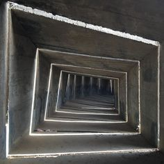 This forms part of a monument in the Negev close to Be'ersheva designed by Dani Karavan built between 1963-1968. It is a concrete tunnel which gets decreasingly smaller. The white lines are created by bright light shining through illuminating the dense dark concrete space. It was created in memory of the Negev Brigade. At its entrance you can stand straight but as you precede further in you crouch more and more until it becomes impossibly small. Karavan is a sculptor whose father was the…
