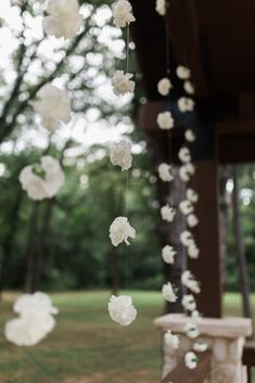 """For the DIY bride:  hang flower strands from your outdoor ceremony pavilion for a gorgeous, elegant backdrop while you are saying your """"I do""""s.  Such a pretty + unique wedding idea! Photo taken at the outdoor ceremony site of THE SPRINGS in Rockwall, Poetry Hall.  Follow this pin to our website for more information, or to book your free tour! Photographer:  Texas Sweet Photography #diywedding #diybride #diyweddingdecor #weddingdecorations #weddingdecor #uniqueweddingideas #weddingflowers"""