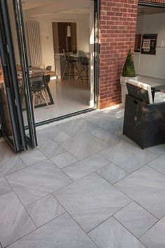 Bradstone Natural Granite Setts in Silver Grey Bradstone Aspero Porcelain Paving in Silver Grey Paving Garden Slabs, Garden Tiles, Patio Slabs, Patio Tiles, Paved Patio, Garden Paving, Bradstone Paving, Paving Stones, Paving Stone Patio