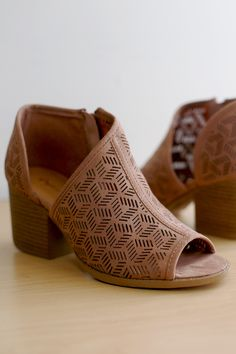 Free SH & Easy Returns! Shop These stylish booties feature a perforated vegan suede upper, peep toe silhouette, side cutout design, and stacked block heel.