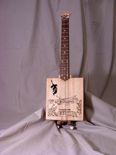 Cigar box baritone ukulele from Papa's Boxes kit | Flickr - Photo Sharing!