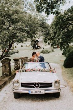 Vintage Decorated Wedding Car With Flowers