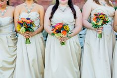 These colorful bouquets pop against the champagne dresses | Harbour View in Northern VA | Megan Kelsey Photography