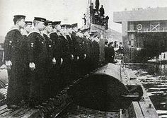 The crew of IJN submarine I-8 at attention on deck upon return from a mission.