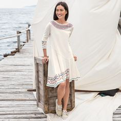 """BRAVURA EMBROIDERED DRESS--You are the star of the show in this easy-fit, embroidered dress, embellished with tiny beads, asymmetrical hemline and exposed seaming. Cotton/polyester. Hand wash. Imported. Exclusive. Sizes XS (2), S (4 to 6), M (8 to 10), L (12 to 14), XL (16). Approx. 37-1/2""""L."""