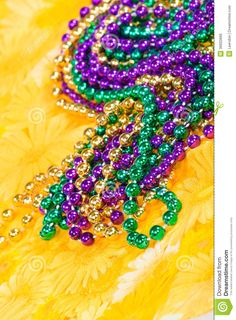 Photo about Colorful Mardi Gras beads against yellow background. Shallow depth of field. Image of beads, sparkle, celebration - 36650666 Mardi Gras Beads, Yellow Background, Shallow, Outdoor Blanket, Colorful, Stock Photos, Shirt, Fun, Image