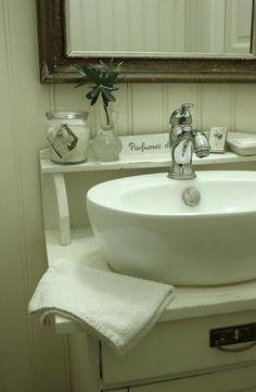 Vintage bathroom, love this vanity with vessel sink
