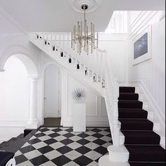 #interior #interiordesign #black #white #jonathanadler #stairs #lighting #chandelier #nickel #bamboo #checkered #flooring #marble #architecture #art #runner #steps #classic #millwork #columns #archway #entry #foyer #designcrush #design