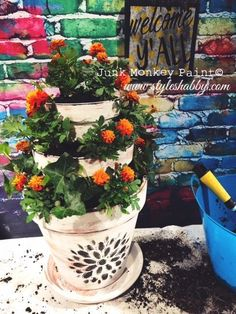 Create a beautiful entryway with this DIY craft project for using terracotta pots to create a stacked / tiered flower display! Such a gorgeous project idea for spring! Check it out! #spring #gardening #terracotta #plants #flowers #planting #decorating #homedecor #diy #crafts #painting #homedesign #homedesignideas #pottedplants