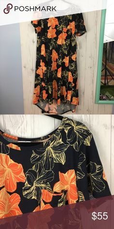 Lularoe Carly Lularoe Carly, never worn, new with tags. Size L. Background is very dark, barely noticeable blue and black. LuLaRoe Dresses Midi