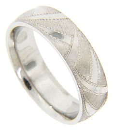 Swooping sections of Florentine finished gold alternate with smoothly polished portions on the surface of this 14K white gold antique style men's wedding band. The band measures 6.1mm in width. Size: 10. Cannot be re-sized, but we can reorder the ring in other sizes. Also available in 18K, yellow gold, platinum or palladium. Price will vary depending on metal and size.