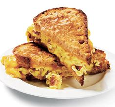 Yummy breakfast sandwich with eggs and bacon - Esquire