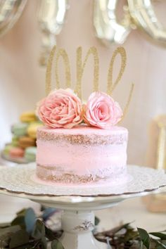 Floral first birthday party naked cake