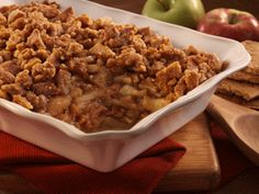 Apple Betty: 1 1/2 cups Keebler® Grahams Honey; 3/4 cup sugar, divided; 1/2 cup margarine or butter, melted; 1 teaspoon cinnamon; 4 medium cooking apples, cored, peeled, thinly sliced
