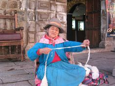 preparing the wool for her craft