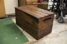 DIY Wooden Chest Bench out of Pallets to hold loveseat cushions