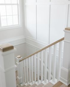 """Oakstone Homes on Instagram: """"This wainscot wall was the perfect finishing touch to these switch back stairs. Swipe to see a close up of the trim detail and the gorgeous…"""" Third Street, House Stairs, Wainscoting, Wall, Touch, Homes, Moldings, Furniture, Staycation"""