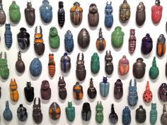 RaR | Schwarm | installation of 63 beetles glazed porcelain | 160 x 240 cm | Edition of 10 | in collaboration with t.e. collection