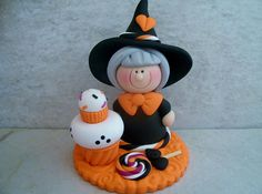 A little witch has some Halloween treats...a double cupcake and a lollipop!  This is an original design that was handcrafted from polymer clay. The piece stands approximately 3 tall and all parts have been secured with liquid polymer for increased strength.   Not a toy...not suitable for young children.