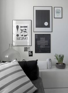 Something like this with all of my black and white art pieces. Different frames to create more interest.