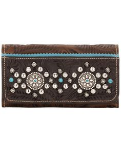 Ladies tri-fold wallet with snap closure. Full leather inside contains flap for checkbook, 13 card slots, 5 compartments. Back has zipper coin pocket. Hand tooled vegetable tanned chestnut brown leather is trimmed in chocolate brown hand tooled leather, and accented with sky blue leather trim. Bold silver spots, turquoise spots, and silver conchos combine perfectly in this classic Western design. Each piece is made by hand, one at a time. This item is backed by the American West Lifetime ...