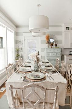 See design ideas and flooring options like this on our website: www.carolinawholesalefloors.com or check us out on Facebook!    Light gray & light tan dining room. great striped walls, hemp table cloth and distressed drawers