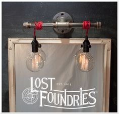 Industrial Pipe Sconce with wrapped up cloth cord. Wilbur design, by Lost Foundries.