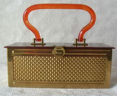 """Amber Lucite top & handle Gold tone Metal base. Logo inside purse reads """" Dexter-Rex Fifth Avenue Design Pat. Pend. """". There are a lot of the Dexter-Rex basket weave purses out there.this one is a unique design and hard to find. 