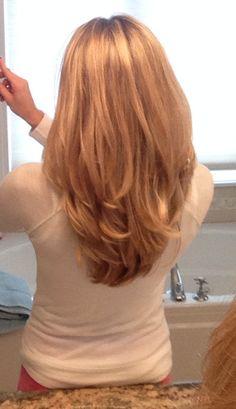 Beautiful rounded medium layered hair cut.