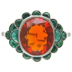 Edwardian Fire Opal Carved Cabochon Emerald Platinum Ring | From a unique collection of vintage cluster rings at https://www.1stdibs.com/jewelry/rings/cluster-rings/