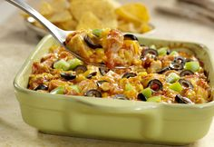 "Monterey Chicken Tortilla Casserole- An easy version of a south-of-the-border classic ""chilaquiles."" This dish uses leftover tortilla chips layered with chicken, Pace® Picante, corn, olives and cheese."