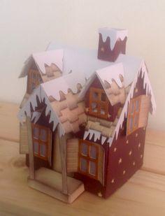 Tim Holtz. Village dwelling. Burgundy star paper. Shingles with snow addition.