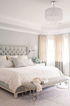 This bedroom is the perfect mix of grey and white.