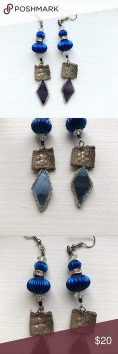 Blue & silver boho bead Free People drop earrings Blue, silver, and gray beaded boho/bohemian drop dangle earrings from Free People. The earrings measure 3.25 inches by .5 inches. Silver tone hardware. The earrings are comprised of clear, multifaceted beads, blue round ornament-like beads, a faux tiny diamond rhinestone silver separator bead, and a metallic silver threaded square that is connected to & is the trimming around a pale blue mirrored diamond shard. These earrings are older & have…