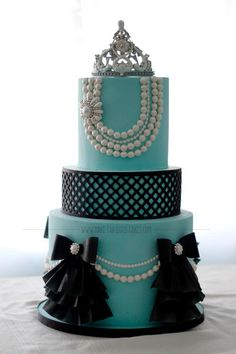"""I made this cake for my niece's first birthday, the theme was based from the movie """"Breakfast at Tiffany's"""". Fondant cake with gumpaste crown and wafer paper ruffles. More details about this cake and the party..."""