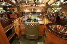1955 Airstream Flying Cloud. There's so much going on in this pic I don't know where to look!