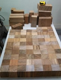 Here are the Teak wood squares cut into perfect cubes and put next to each other for the top of the table