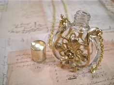 Hey, I found this really awesome Etsy listing at https://www.etsy.com/listing/66819374/vintage-perfume-bottle-necklace